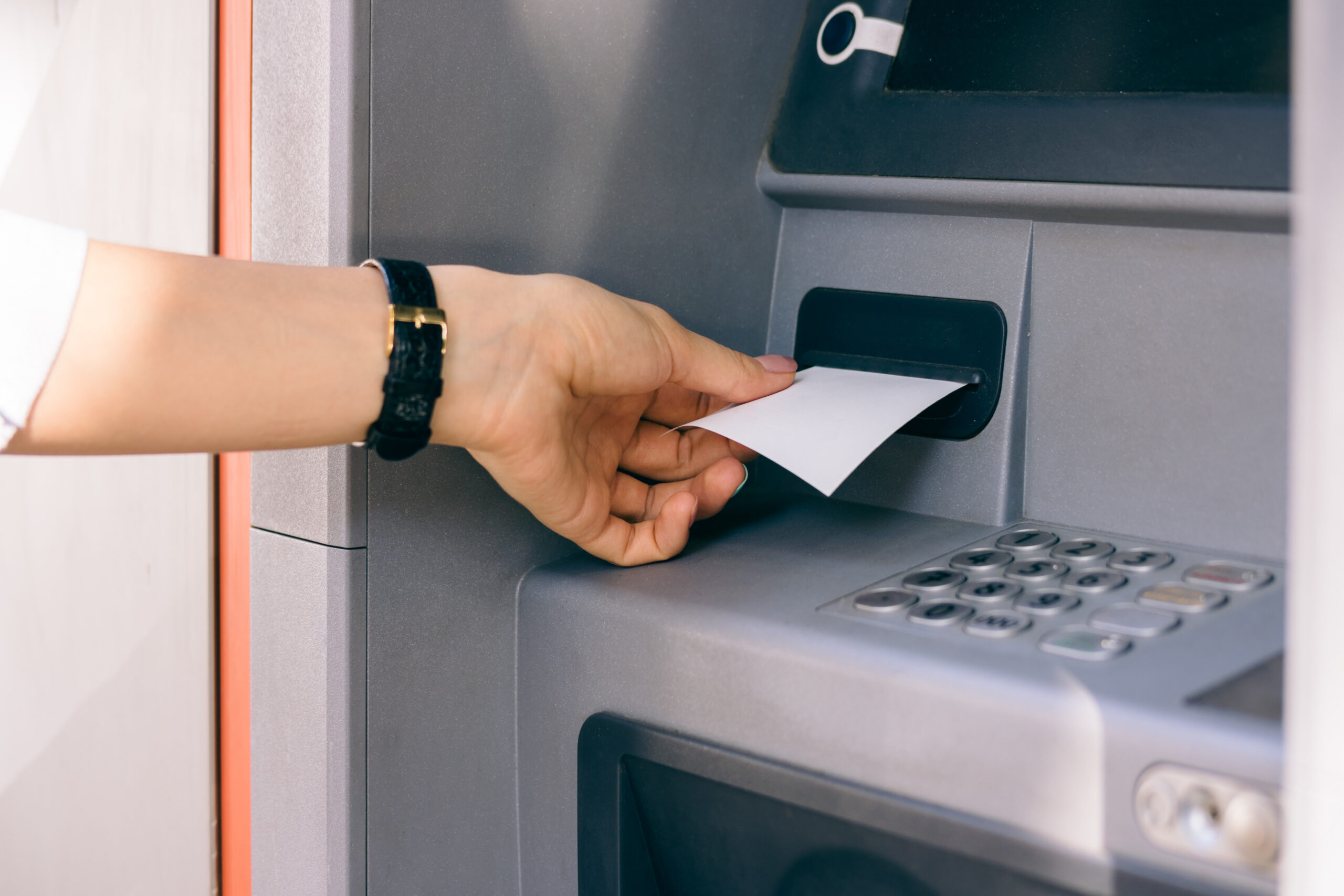 Person obtaining ATM receipt